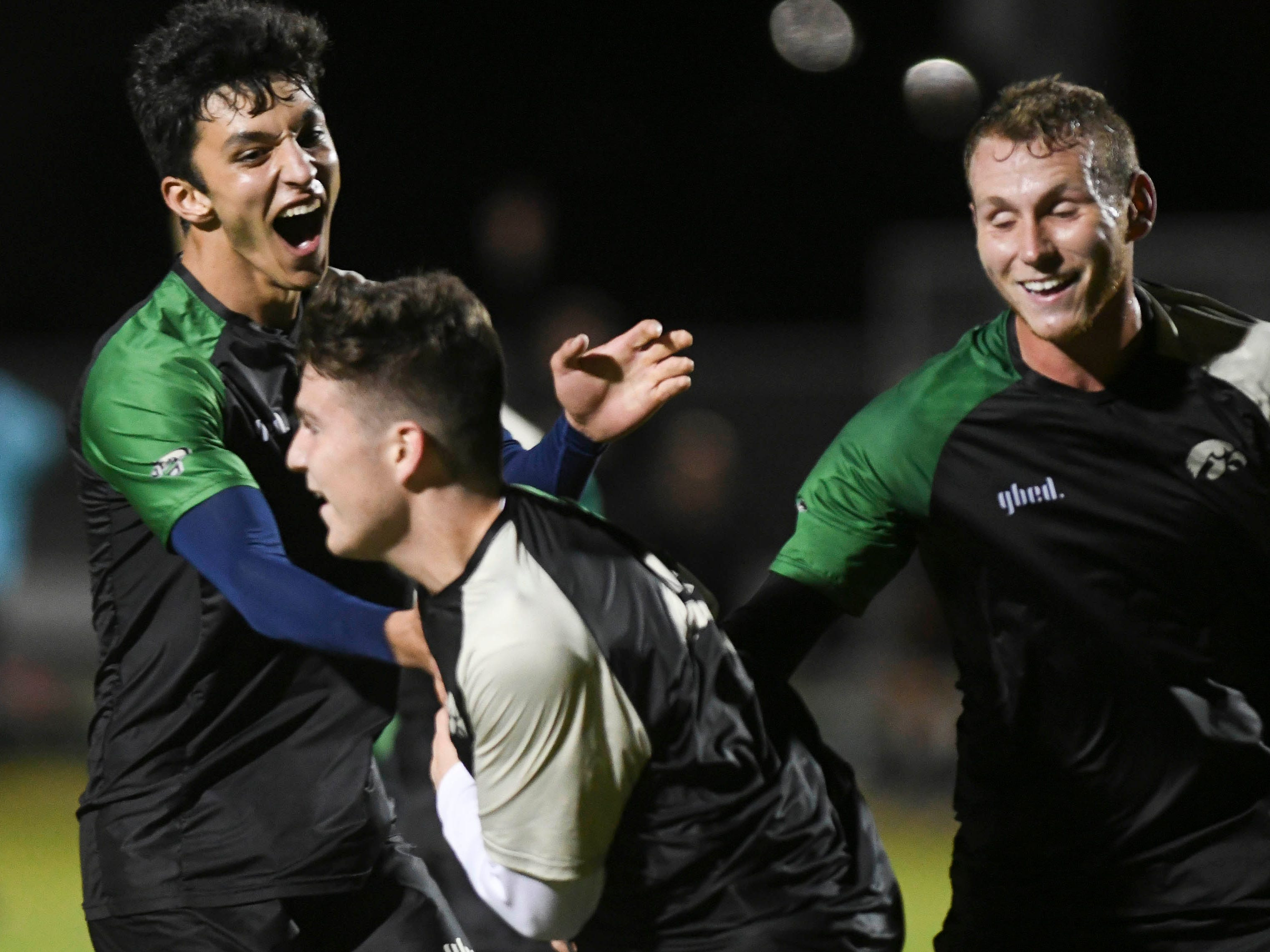 Christian Becerra of Viera celebrates his first half goal with teammates during Friday's game against MCC.