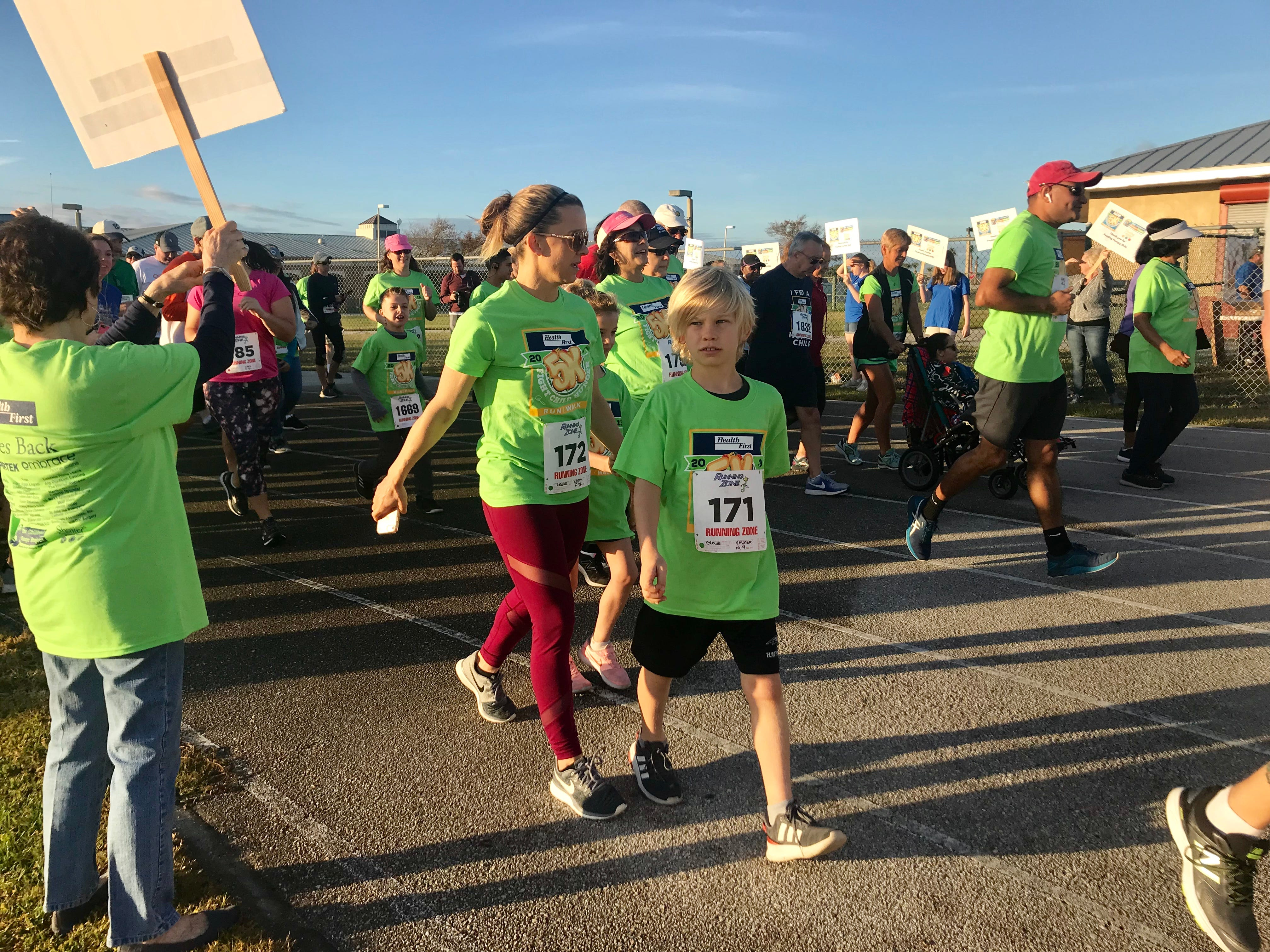 Athletes participate in the End Child Hunger 5K Run/Walk at Viera High School Saturday morning