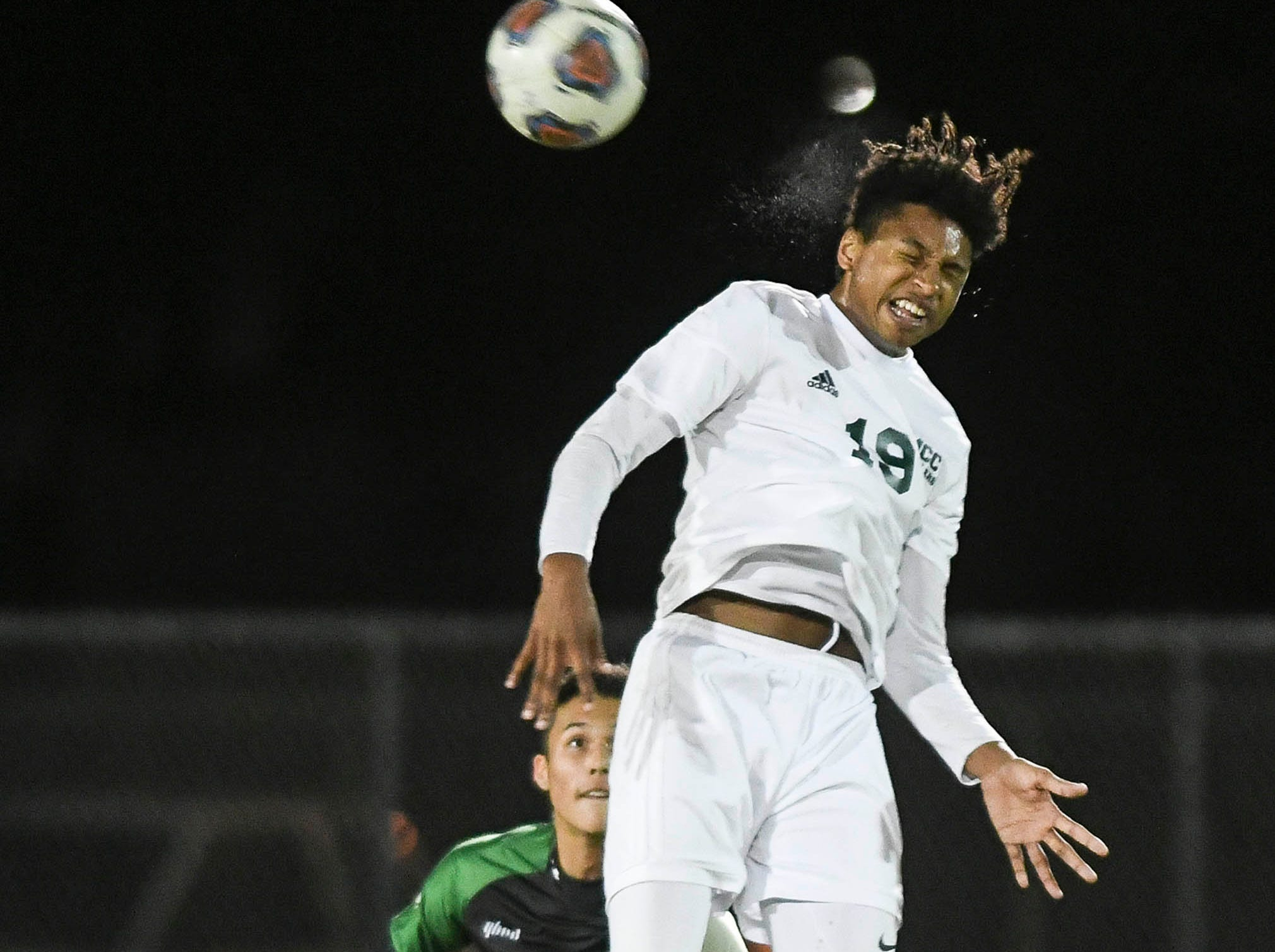 Issac Begin of Melbourne Central Catholic heads the ball during Friday's game in Viera