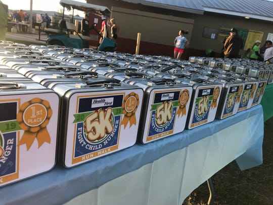 Lunchboxes lined up for the winners of the End Child Hunger 5K in Viera.