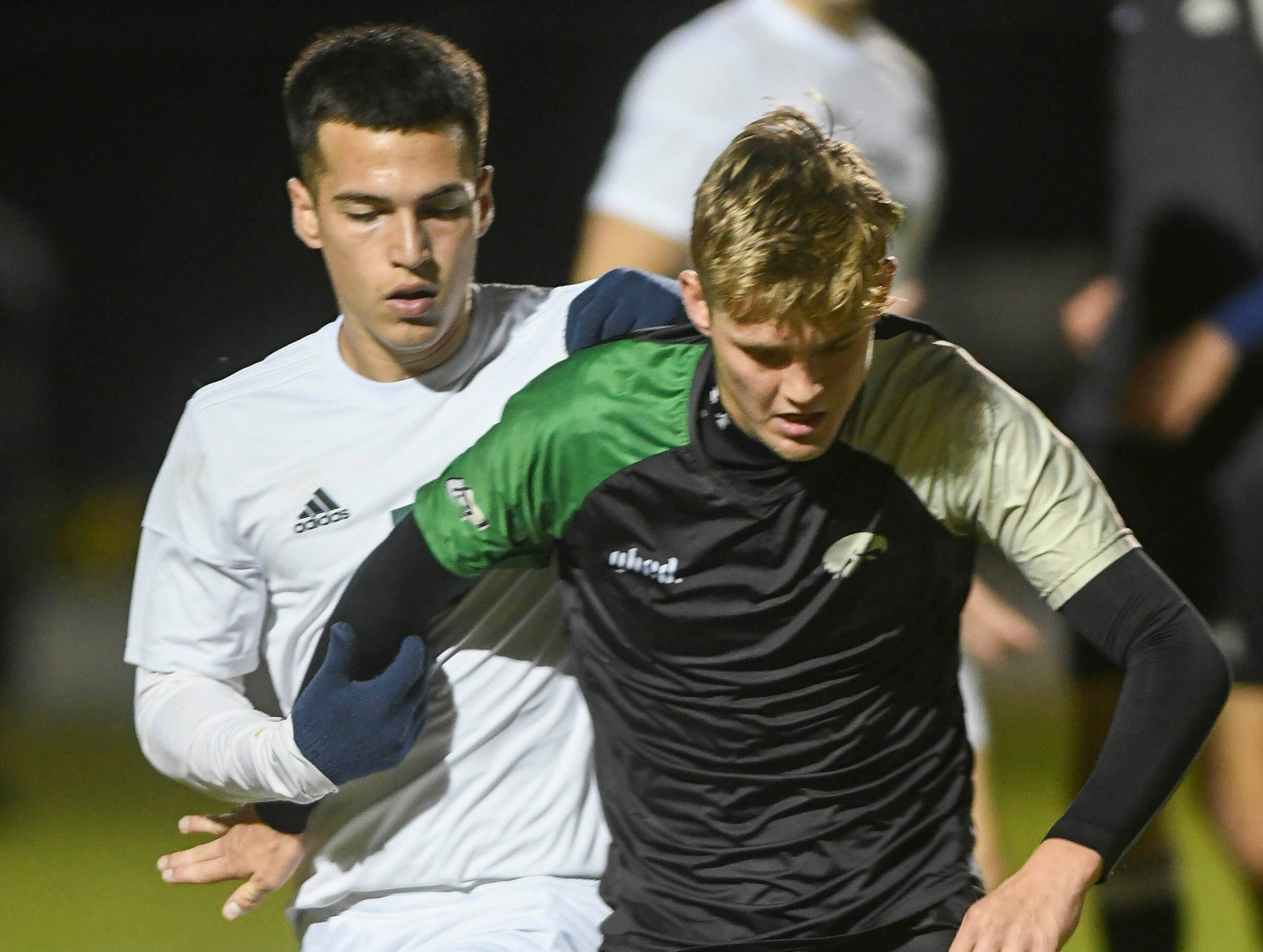 Ben Pena of Melbourne Central Catholic and Mads Jensen of Viera battle for control of the ball during Friday's game in Viera