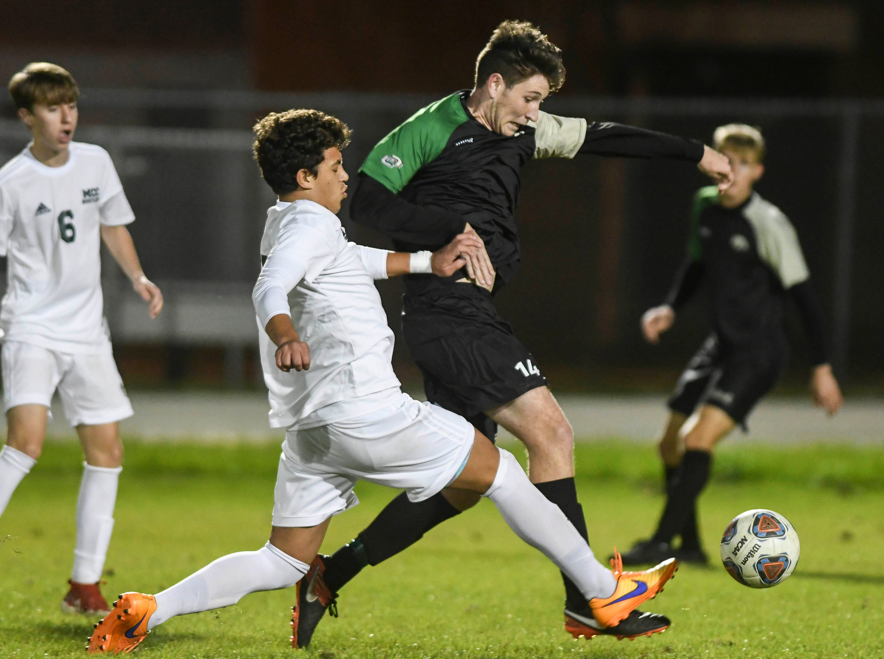 MCC's Geraldo Filho redirects the ball away from Patrick Murtha of Viera during Friday's game in Viera