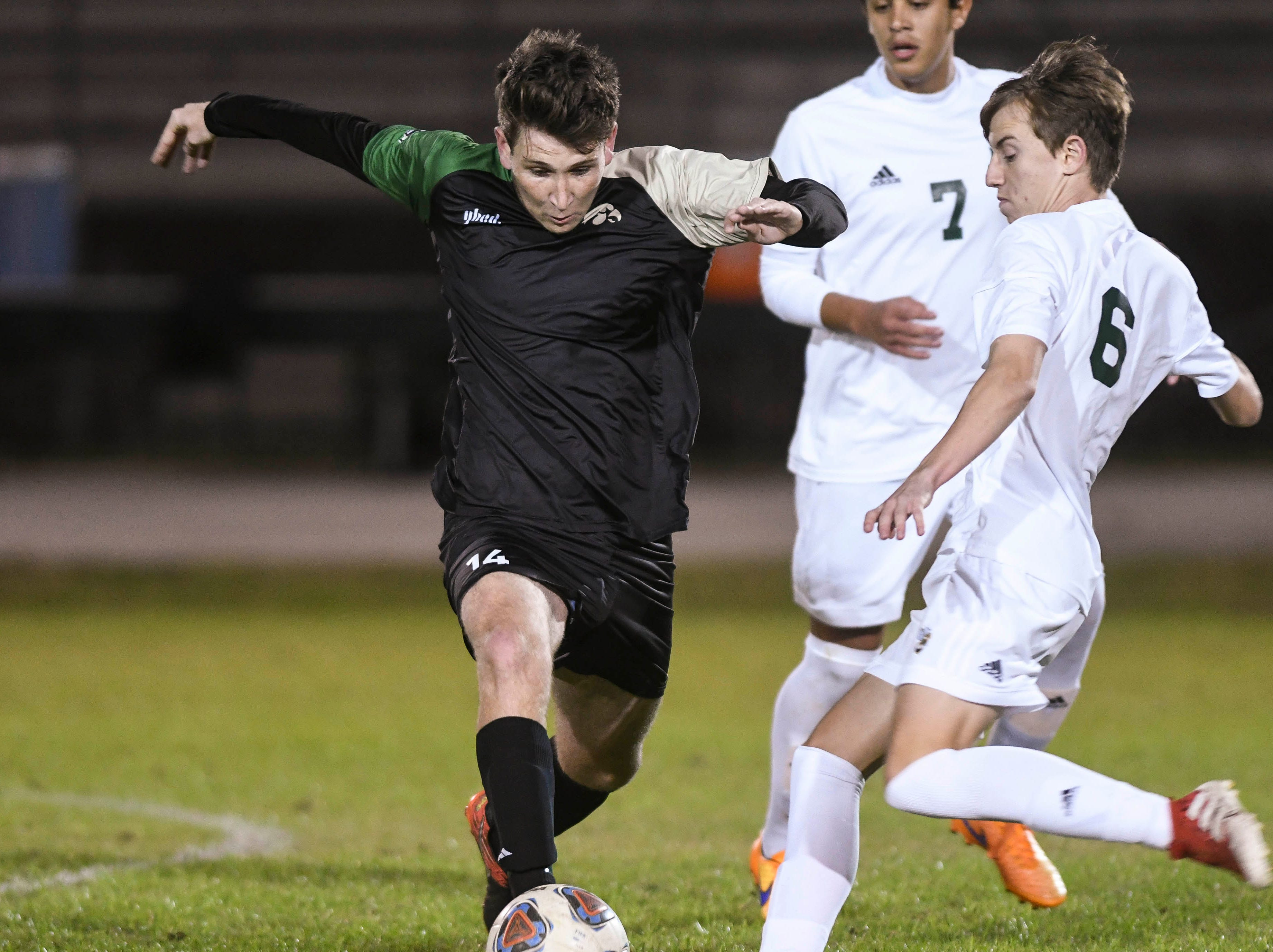 Patrick Murtha of Viera is challenged by Seamus Wixted of Melbourne Central Catholic during Friday's game in Viera.