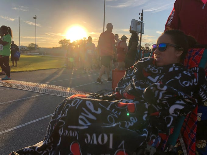 Jessica Gabordi, co-chair of the 2019 Fight Child Hunger 5K at Viera High School, gets ready for the race on Saturday, Jan. 12, 2019. This is the third year that Jessica and her dad, FLORIDA TODAY Executive Editor Bob Gabordi, have chaired the 5K.