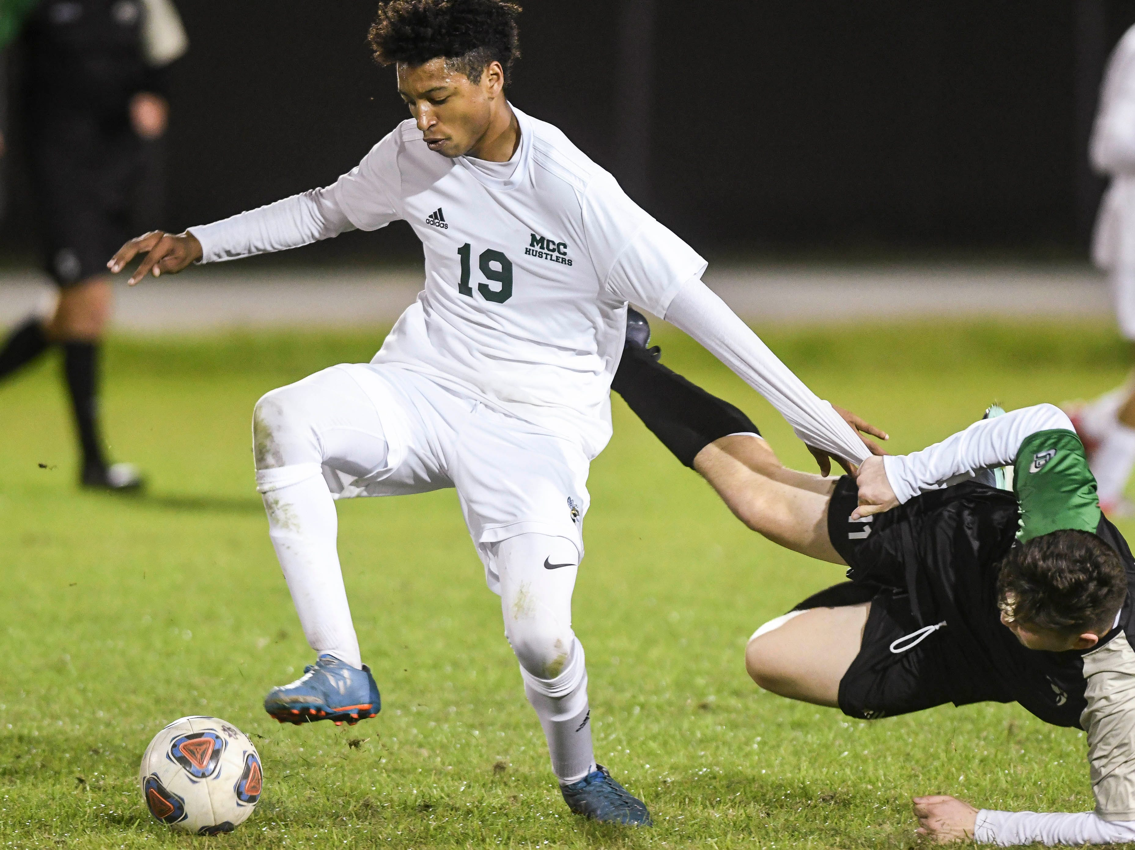 Issac Begin of Melbourne Central Catholic and Christian Becerra of Viera get tangled up during friday's Game in Viera.