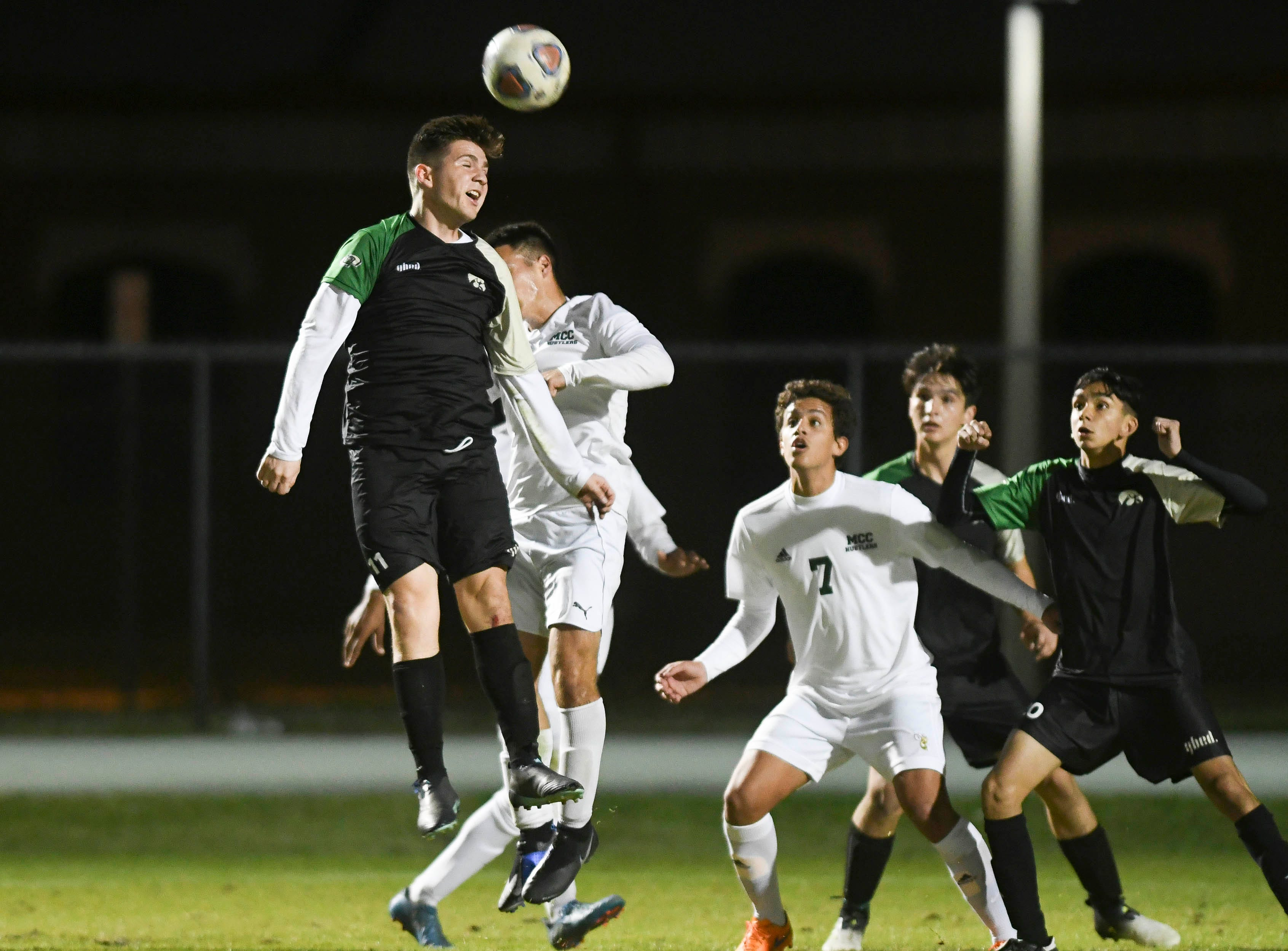 Christian Becerra of Viera heads the ball away from the Hawks goal during Friday's game in Viera
