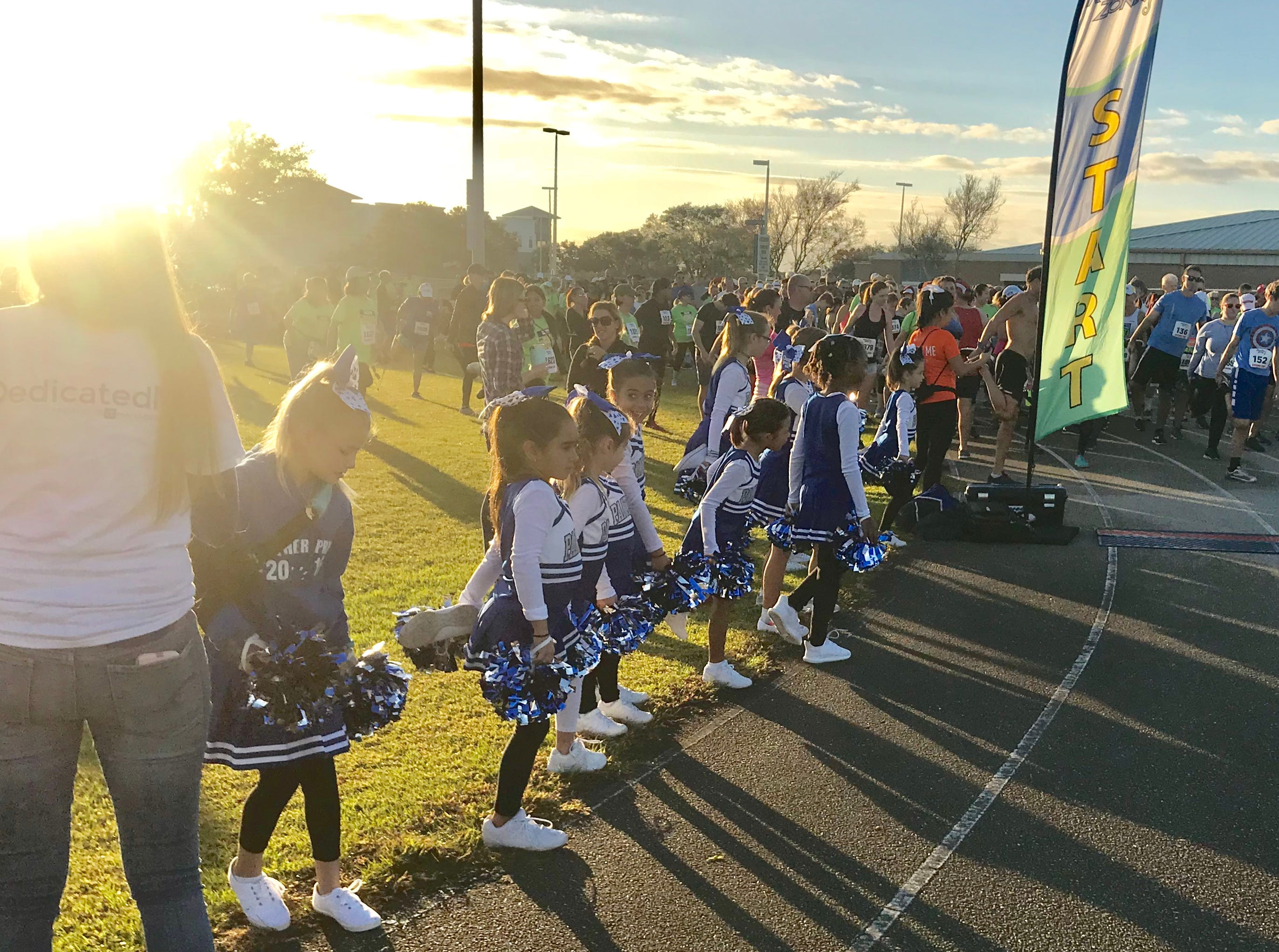 Participants were cheered on at the End Child Hunger 5K at Viera High School