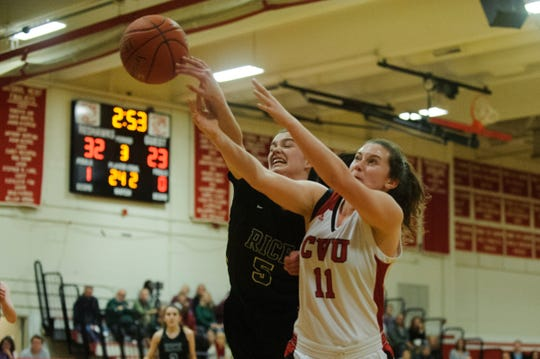 CVU's Meghan Gilwee (11) and Rice's Petra Langan (5) battle for the loose ball during high school girls basketball game between the Rice Green Knights and the Champlain Valley Union Redhawks at CVU High School on Friday night January 11, 2019 in Hinesburg.