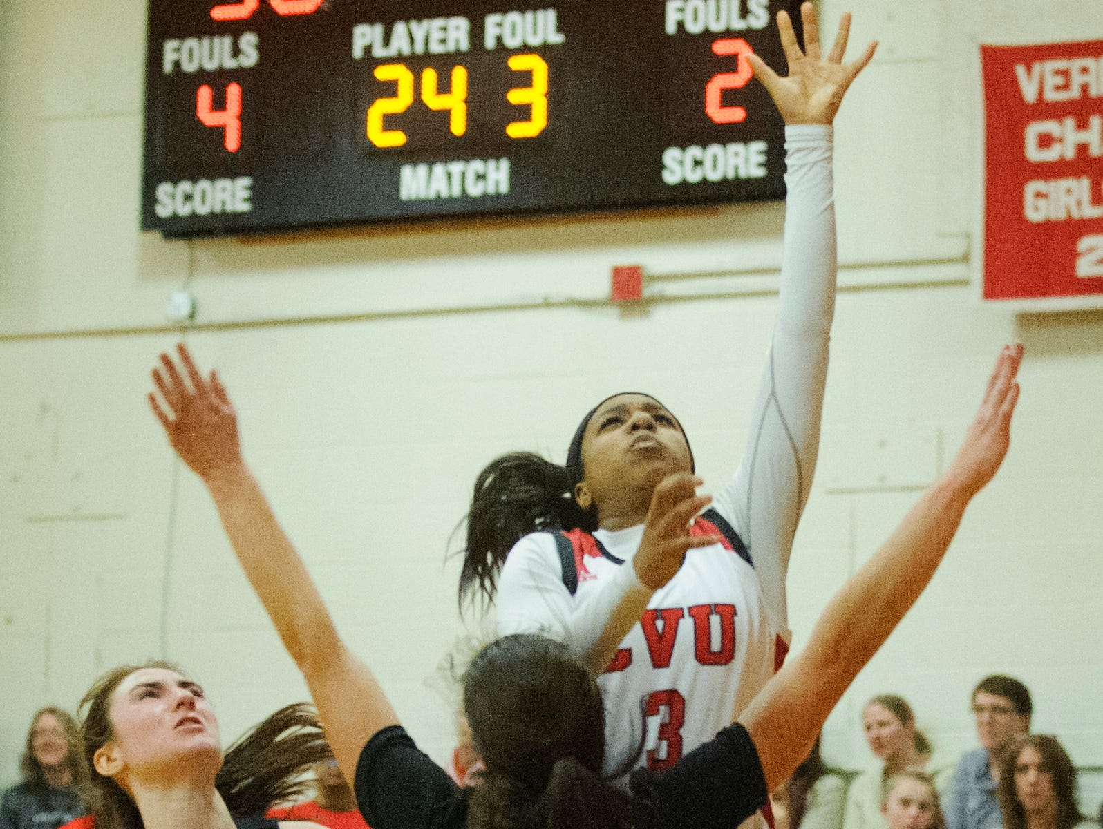 CVU's Mekkena Boyd (3) leaps to take a shot over Rice's Petra Langan (5) during high school girls basketball game between the Rice Green Knights and the Champlain Valley Union Redhawks at CVU High School on Friday night January 11, 2019 in Hinesburg.
