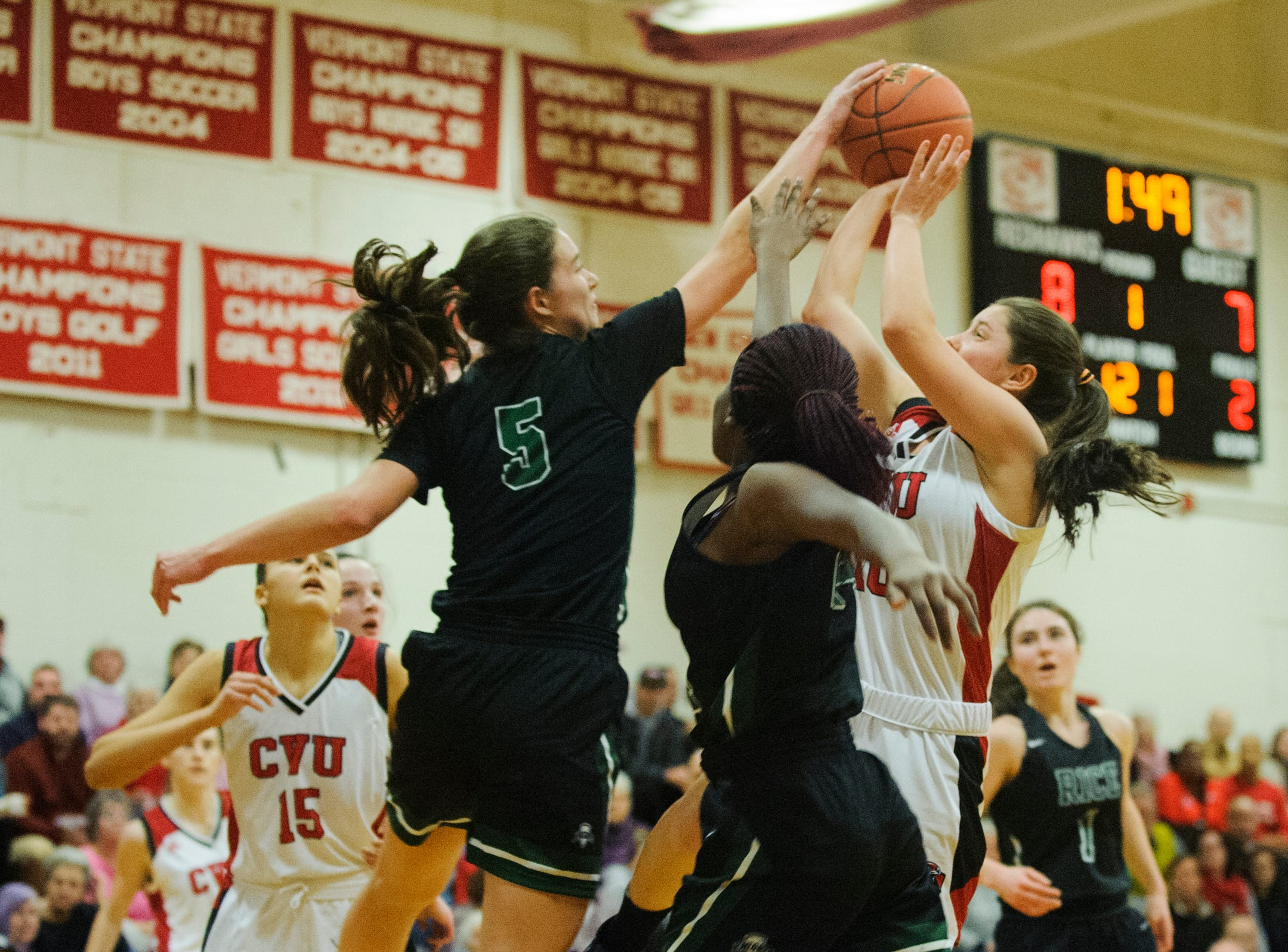 Rice's Petra Langan (5) blocks the shot by CVU's Quinn Boardman (10) during high school girls basketball game between the Rice Green Knights and the Champlain Valley Union Redhawks at CVU High School on Friday night January 11, 2019 in Hinesburg.