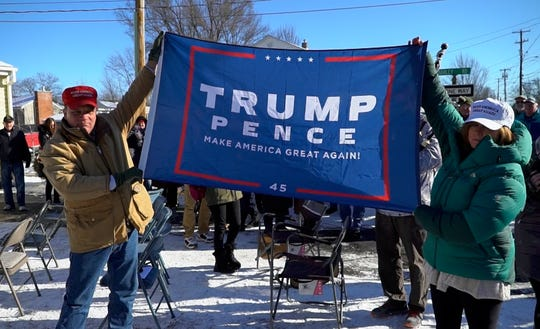 Gus and Annmarie Klein of Burlington, VT, show the new flag they say was sent by the Trump family after a pro-Trump flag was taken down from a flag pole on their front yard, burnt, and left on their front step in the middle of the night by vandals. The Kleins held a ceremony on Saturday, Jan. 12, 2019, raising the new flag and displaying several others around their home.