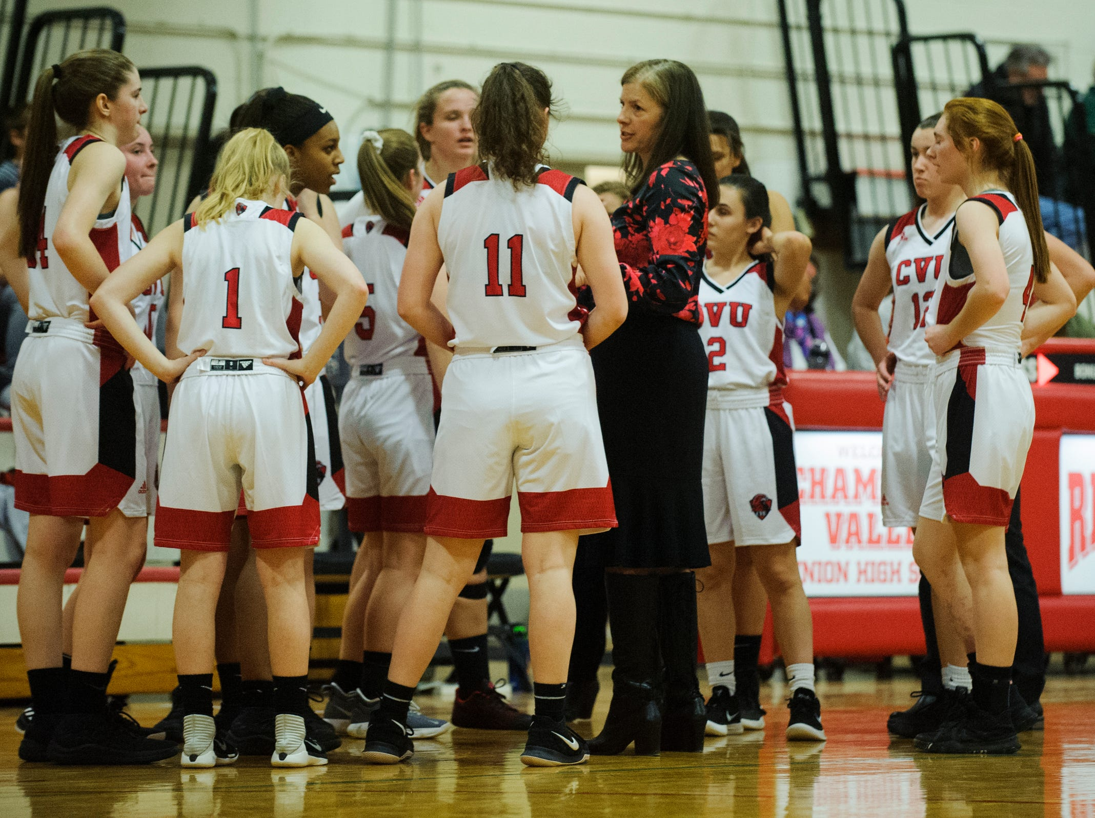 CVU head coach Ute Otley talks to the team during a time out in the high school girls basketball game between the Rice Green Knights and the Champlain Valley Union Redhawks at CVU High School on Friday night January 11, 2019 in Hinesburg.
