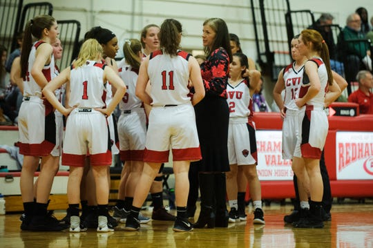 CVU head coach Ute Otley talks to the team during a timeout in the high school girls basketball game between the Rice Green Knights and the Champlain Valley Union Redhawks at CVU High School on Friday night January 11, 2019 in Hinesburg.