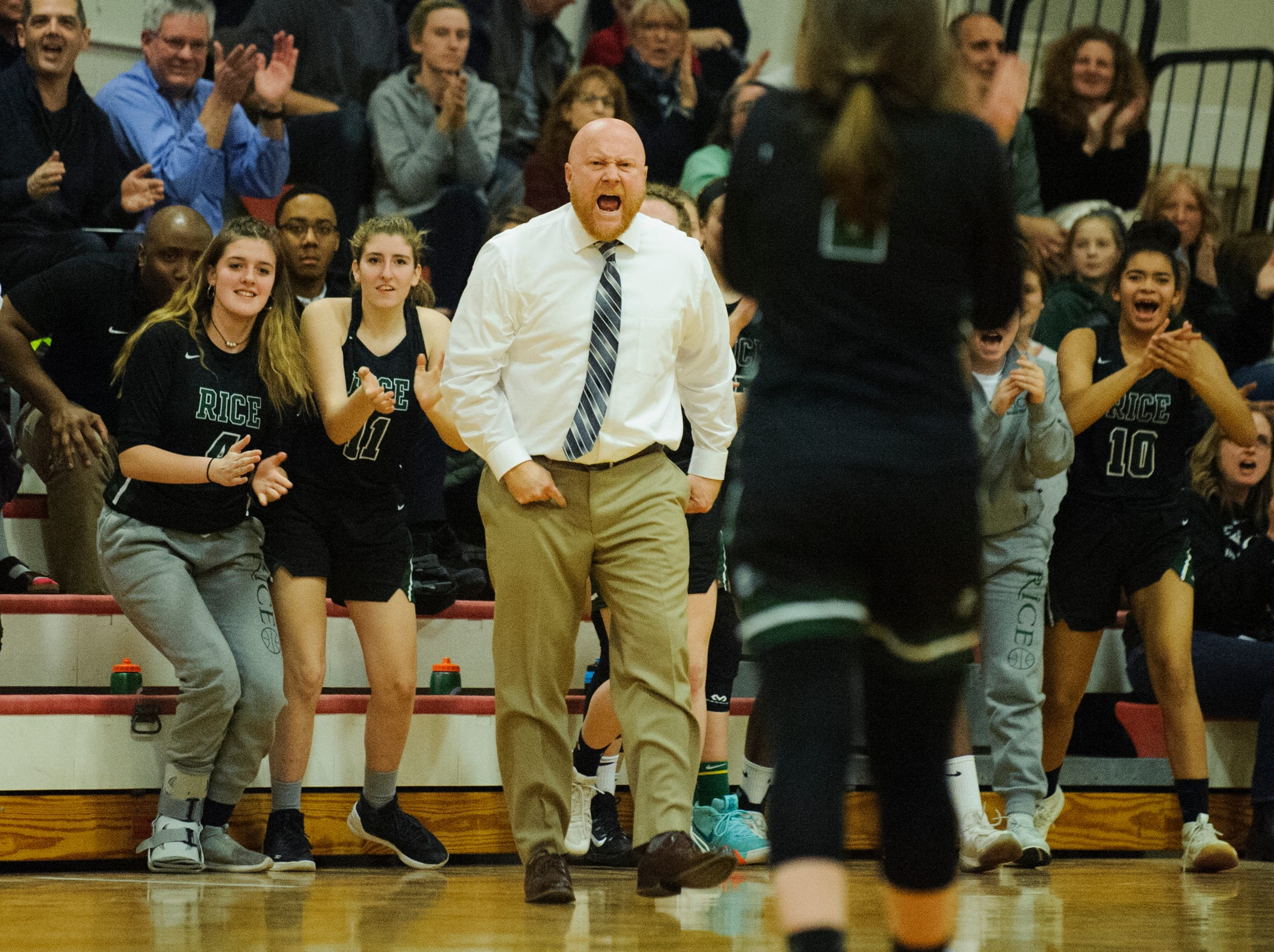 Rice head coach Aurie Thibault cheers for a play during high school girls basketball game between the Rice Green Knights and the Champlain Valley Union Redhawks at CVU High School on Friday night January 11, 2019 in Hinesburg.
