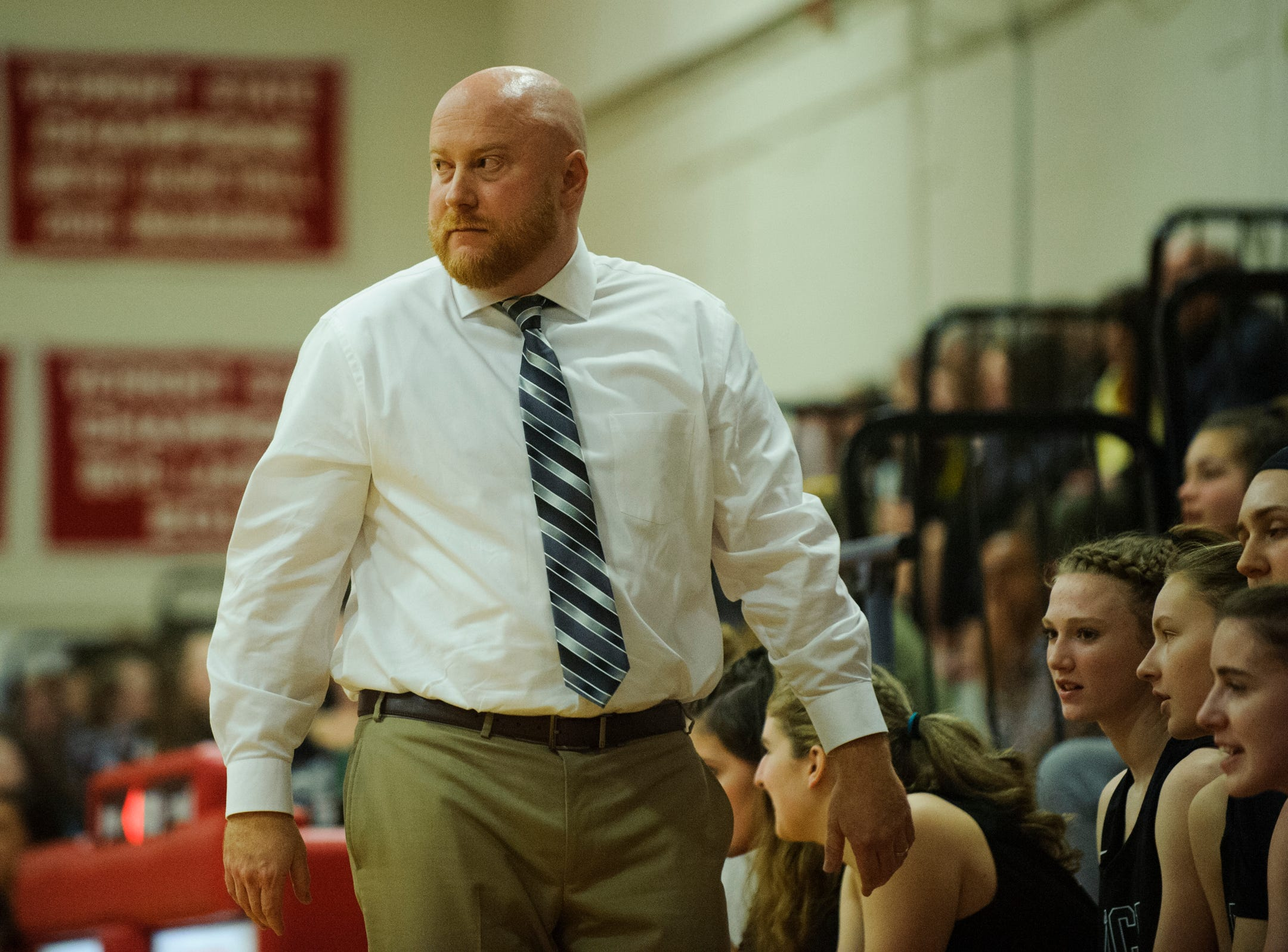Rice head coach Aurie Thibault watches the action on the court during high school girls basketball game between the Rice Green Knights and the Champlain Valley Union Redhawks at CVU High School on Friday night January 11, 2019 in Hinesburg.