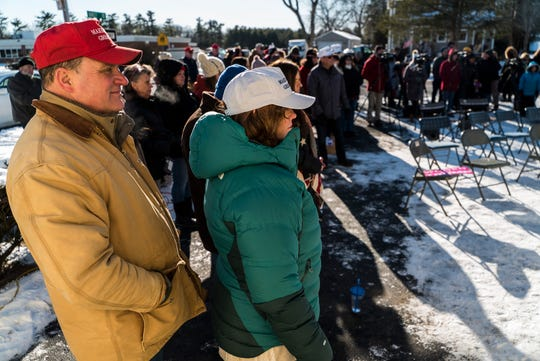 Gus and Annmarie Klein of Burlington, VT, listen to speakers during a ceremony at their home on Saturday, Jan. 12, 2019, to raise a new Trump flag after their old Trump flag was burnt and left on their doorstep by vandals.
