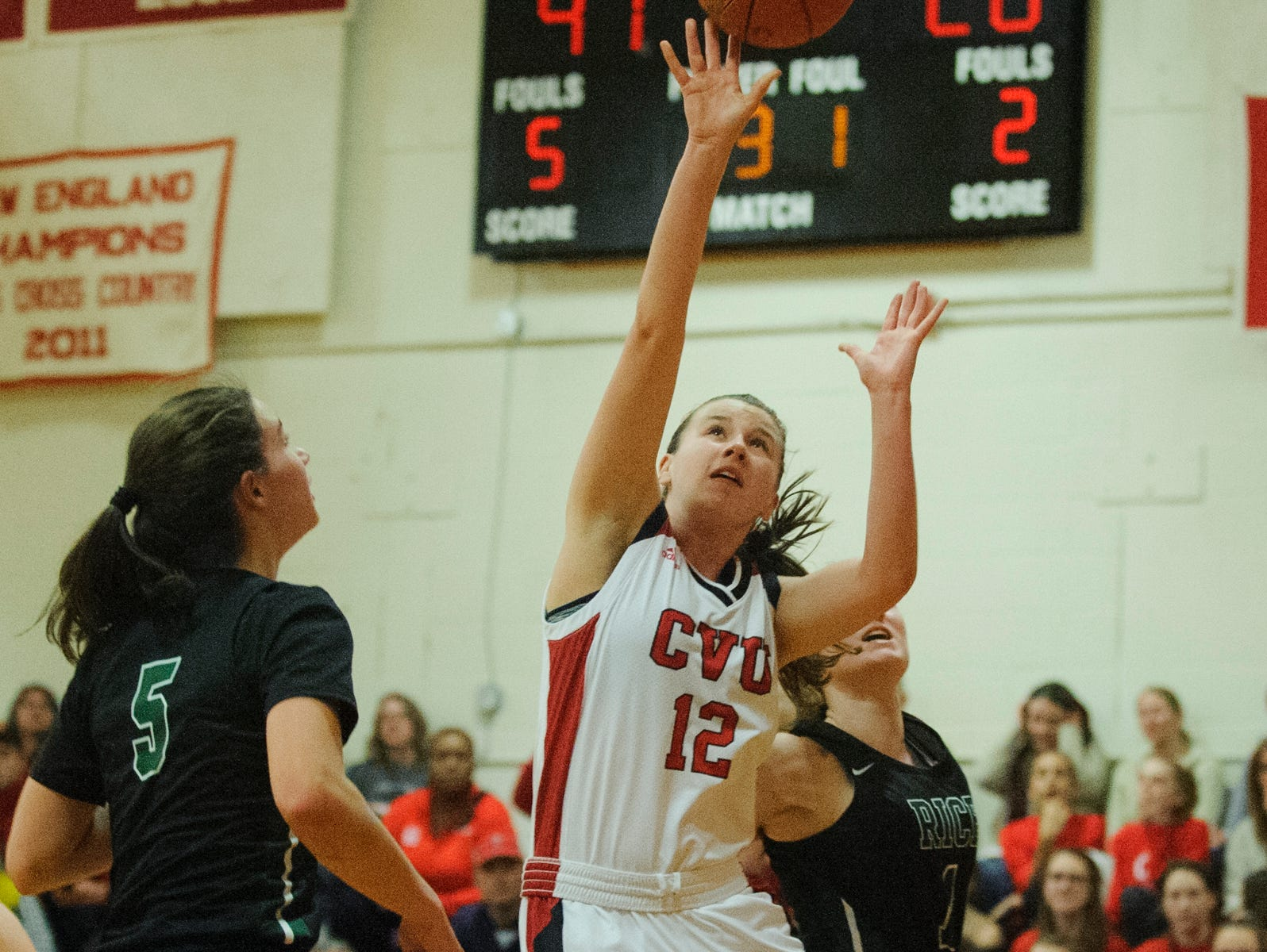 CVU's Harper Mead (12) shoots the ball during high school girls basketball game between the Rice Green Knights and the Champlain Valley Union Redhawks at CVU High School on Friday night January 11, 2019 in Hinesburg.