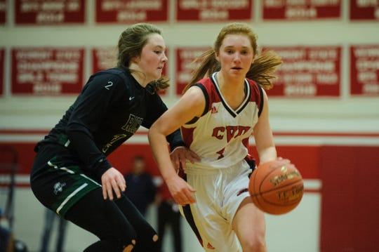 CVU's Catherine Gilwee drives to the hoop past Rice's Fiona Connolly (2) during high school girls basketball game between the Rice Green Knights and the Champlain Valley Union Redhawks at CVU High School on Friday night January 11, 2019 in Hinesburg.