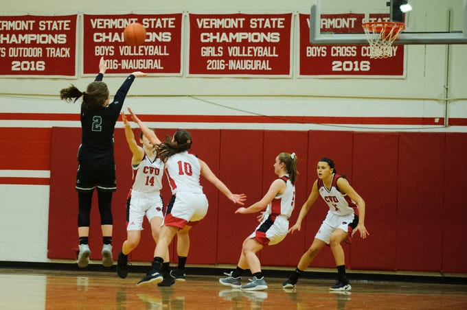Rice's Fiona Connolly (2) shoots a three pointer during high school girls basketball game between the Rice Green Knights and the Champlain Valley Union Redhawks at CVU High School on Friday night January 11, 2019 in Hinesburg.