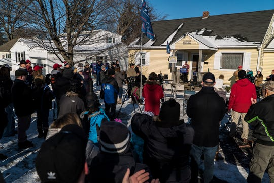 About 75 people attend a ceremony at the home of Gus and Annmarie Klein in Burlington, VT, on Saturday, Jan. 12, 2019, to raise a new Trump flag after their old Trump flag was burnt and left on their doorstep by vandals.