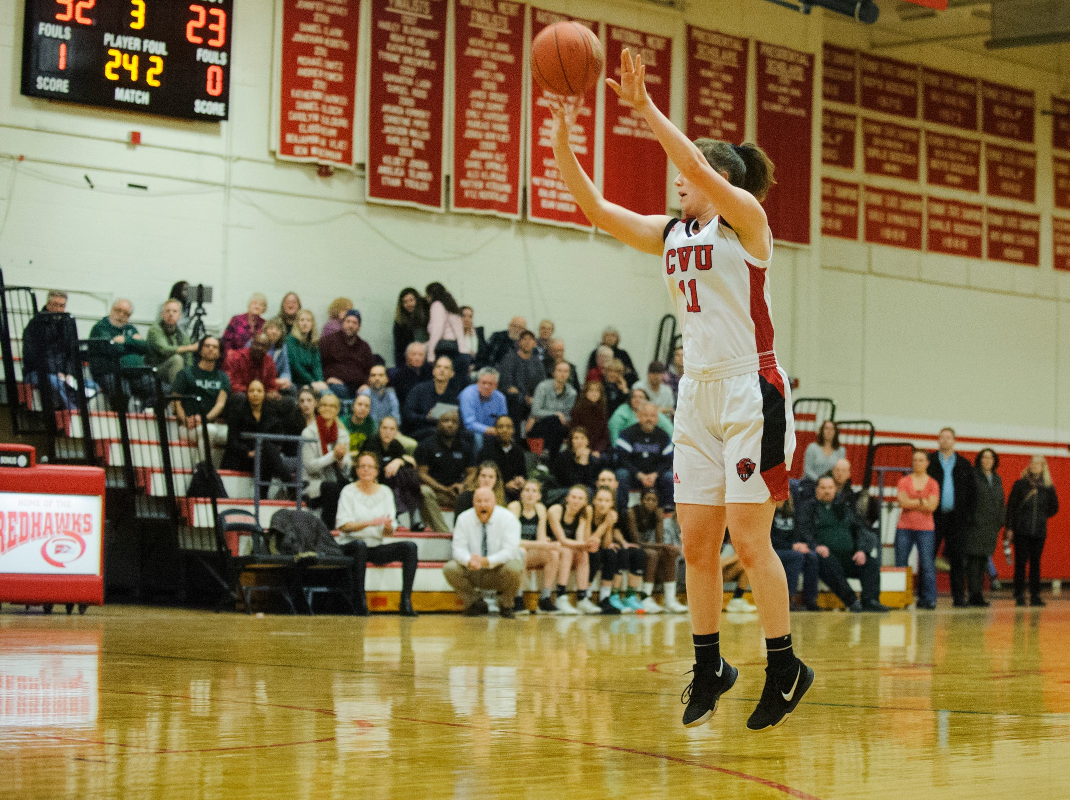 CVU's Meghan Gilwee (11) shoots the ball during high school girls basketball game between the Rice Green Knights and the Champlain Valley Union Redhawks at CVU High School on Friday night January 11, 2019 in Hinesburg.