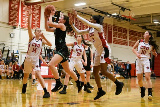 CVU's Mekkena Boyd (3) and Julia Blanck (14) defend Rice's Kristen Varin during a high school girls basketball game last month.