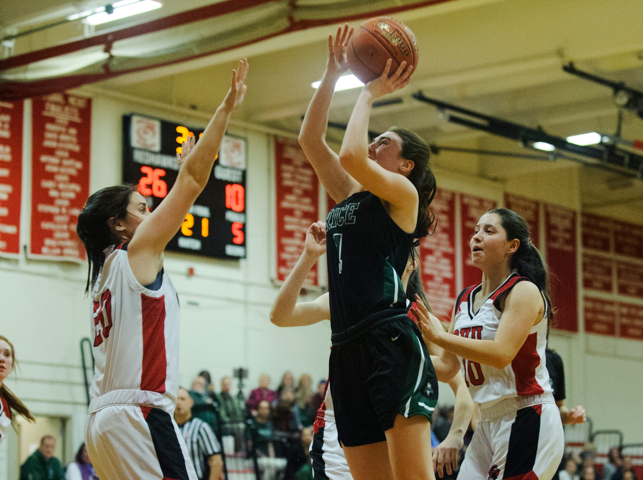 Rice's Sadie Vincent (3) leaps to shoot the ball during high school girls basketball game between the Rice Green Knights and the Champlain Valley Union Redhawks at CVU High School on Friday night January 11, 2019 in Hinesburg.