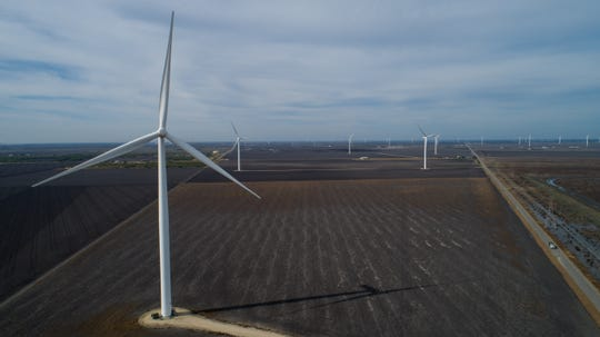 Wind turbines spin in San Patricio County near Portland, Texas on Dec. 12, 2018.Eight of the world's 10 largest wind farms are in the United States. Five of them are in Texas.