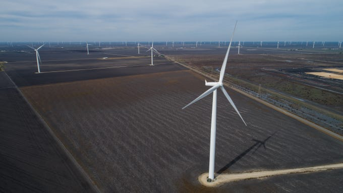 Wind turbines spin in San Patricio County near Portland, Texas on Dec. 12, 2018. There are nearly 13,000 wind turbines operating in Texas for electricity.