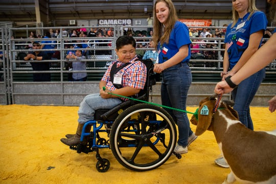 Lorenzo Guerrero exhibits a goat as he and other third grade to 12th grade special needs students show goats and lambs at the Nueces County Junior Livestock Show at the Richard M. Borchard Regional Fairgrounds in Robstown on Saturday, Jan. 12, 2019.