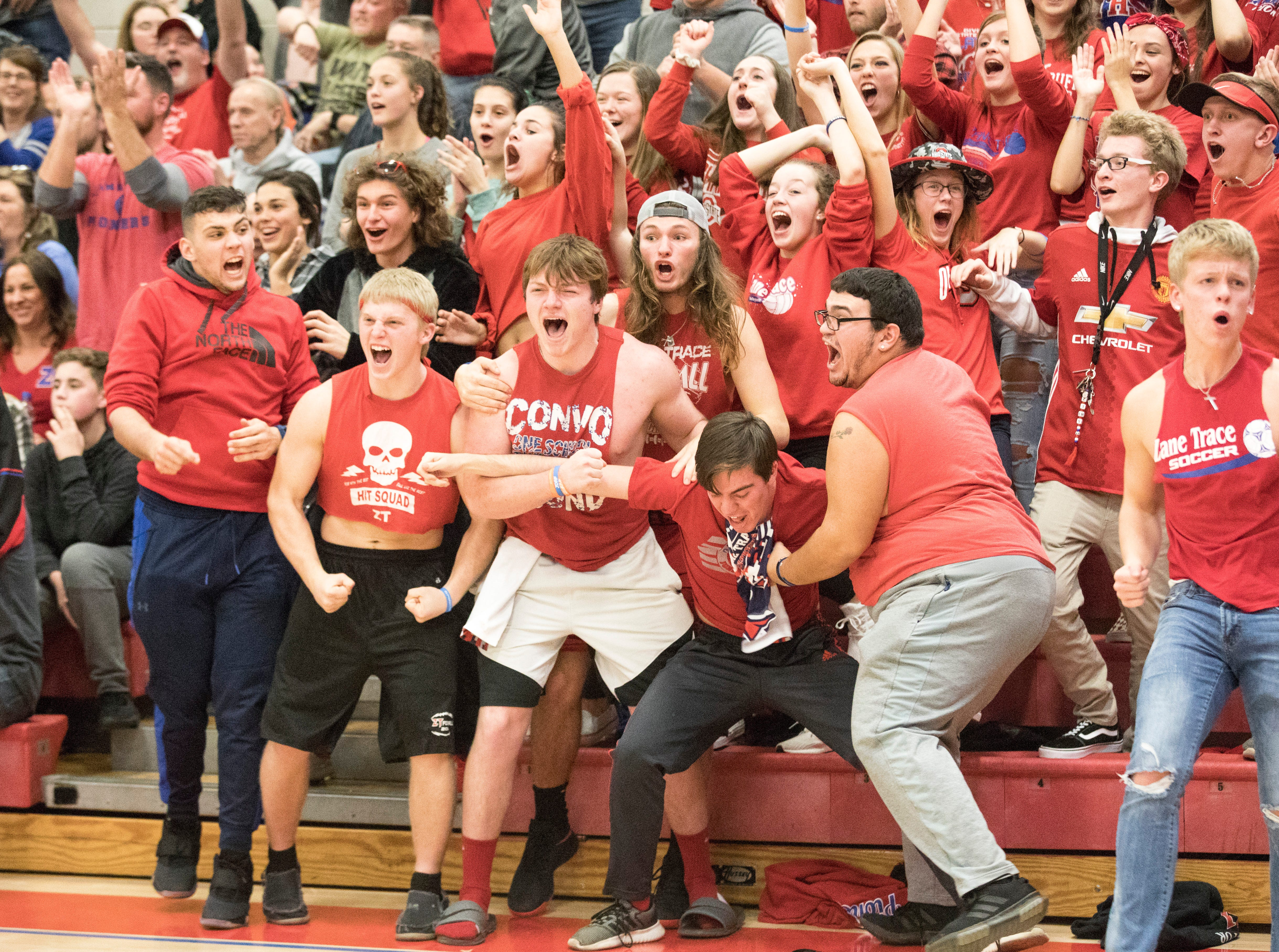 The Zane Trace student section goes wild after seeing an alley-oop dunk from Cam Evans to Triton Davidson Friday night at Zane trace High School.  Zane Trace defeated Unioto 46-35.