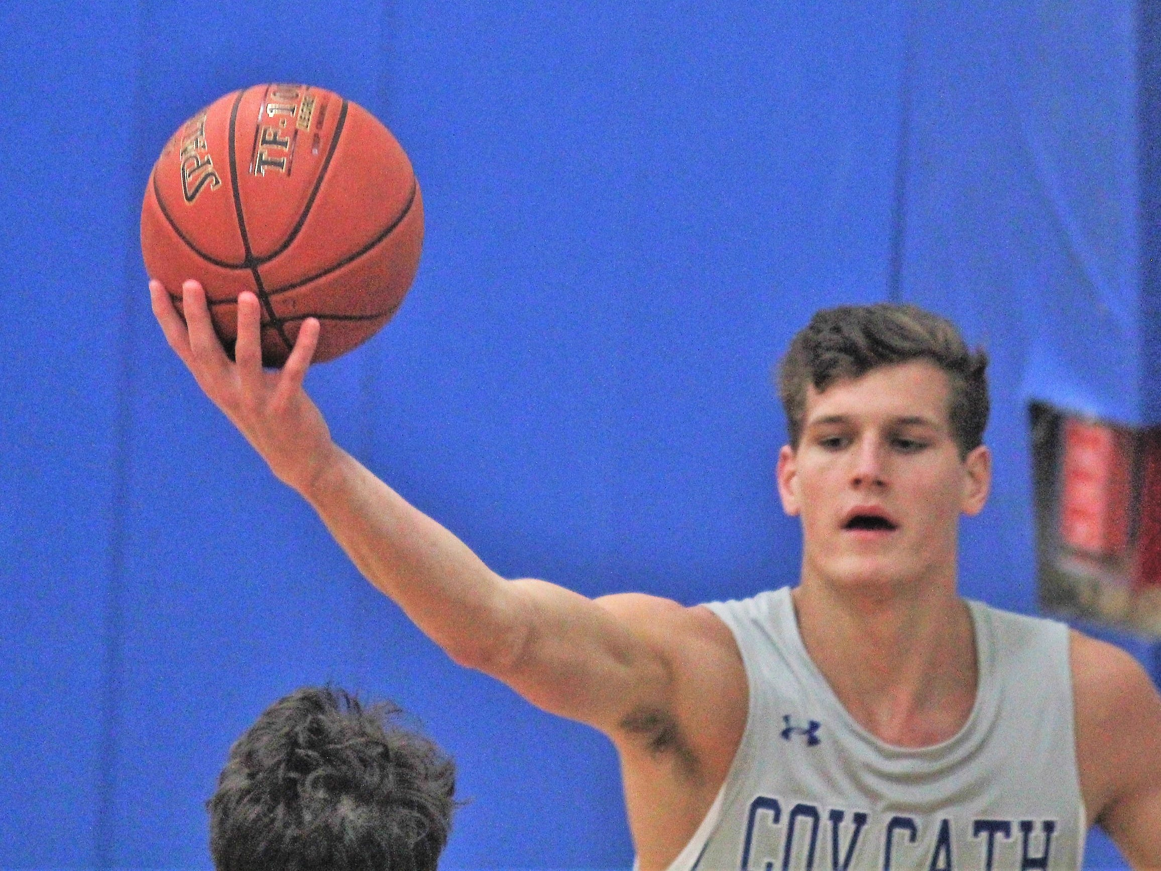 CovCath senior Nick Thelen corrals the ball as Covington Catholic defeats Cooper 53-47 in boys basketball Jan. 11, 2019 at CovCath.