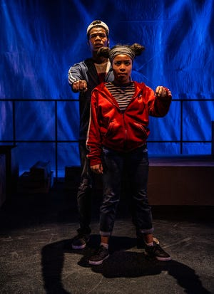 """Sometimes Holly L. Derr's production of """"Red Bike"""" is so intricate that it resembles a choreographic work with dialogue as much as it does a play with movement. Seen here are  Maliyah Gramata-Jones (front) and Montez O. Jenkins-Copeland. The show runs through Feb. 2 at the Know Theatre, Over-the-Rhine."""