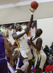 Taft forward  Chris'seon Stringer shoots the ball.