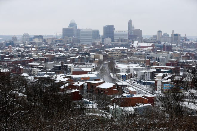 Snow blankets Over-the-Rhine and the Central Business District in Cincinnati on Saturday, Jan. 12, 2019. A winter storm warning remained in effect until 7 a.m. Sunday after the region experienced the first snowfall of 2019.