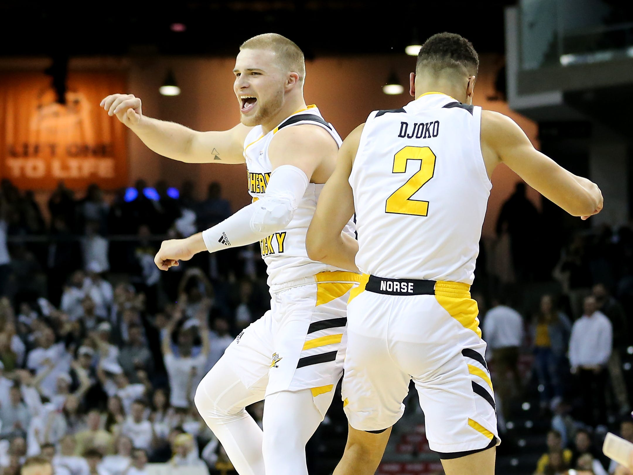 Northern Kentucky Norse guard Tyler Sharpe (15) and Northern Kentucky Norse guard Paul Djoko (2) celebrate the win against the Wright State Raiders, Friday, Jan. 11, 2019, at BB&T Arena in Highland Heights, Ky.