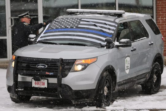 Final adjustments for Police Officer Dale Woods' procession in North College Hill.