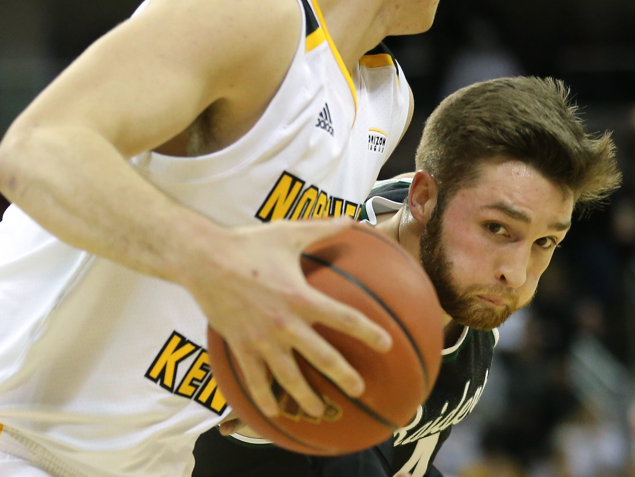 Wright State guard Alan Vest goes for the steal on Norse forward Drew McDonald in the first half on Friday.