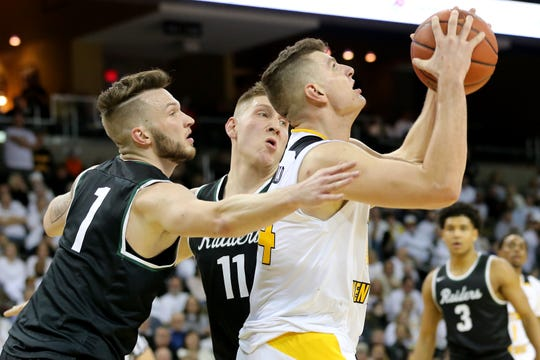 Northern Kentucky Norse forward Drew McDonald (34) eyes the basket as Wright State Raiders forward Billy Wampler (1) defends in the second half of an NCAA basketball game, Friday, Jan. 11, 2019, at BB&T Arena in Highland Heights, Ky.