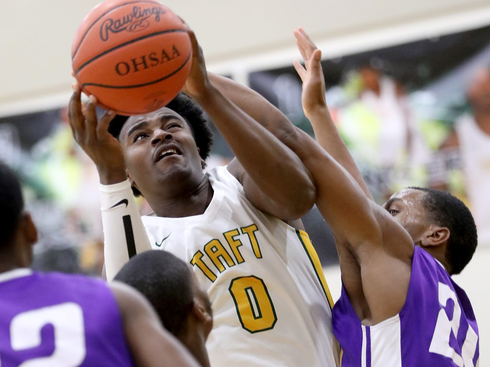 Taft forward  Cleveland Farmer grabs a rebound.
