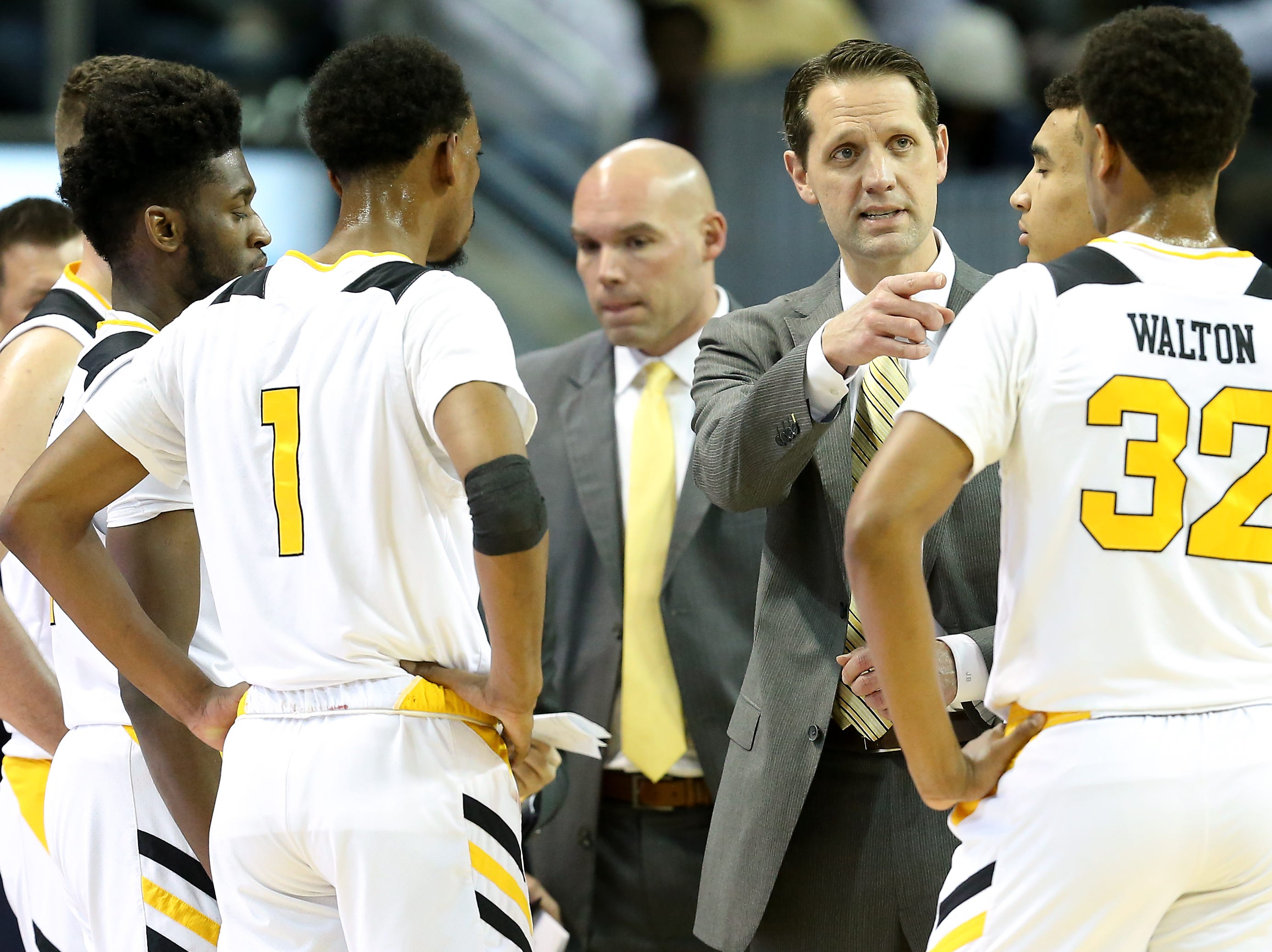 Northern Kentucky head coach John Brannen instructs the team during a timeout in the first half.