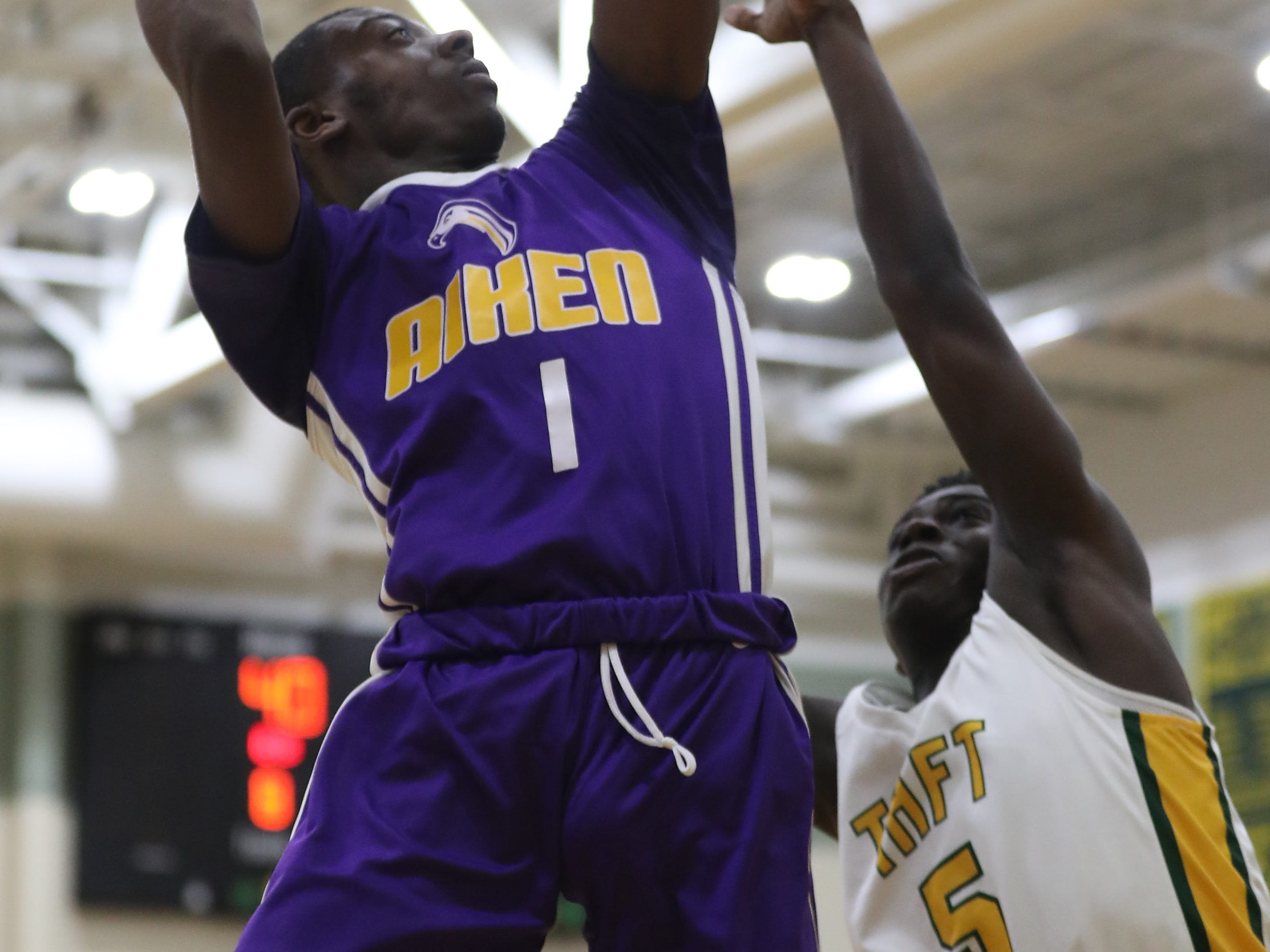Aiken guard  D'Arris Dean drives to the basket.