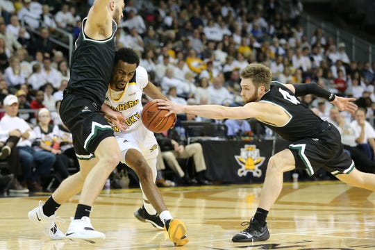 Northern Kentucky Norse guard Jalen Tate (11) drives to the basket as Wright State Raiders guard Alan Vest (4) reaches for the steal.