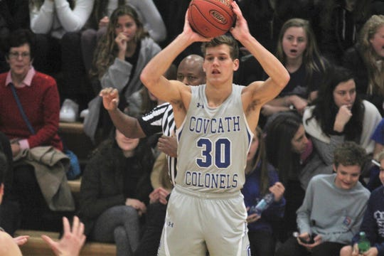 CovCath senior Nick Thelen looks to pass as Covington Catholic defeats Cooper 53-47 in boys basketball Jan. 11, 2019 at CovCath.