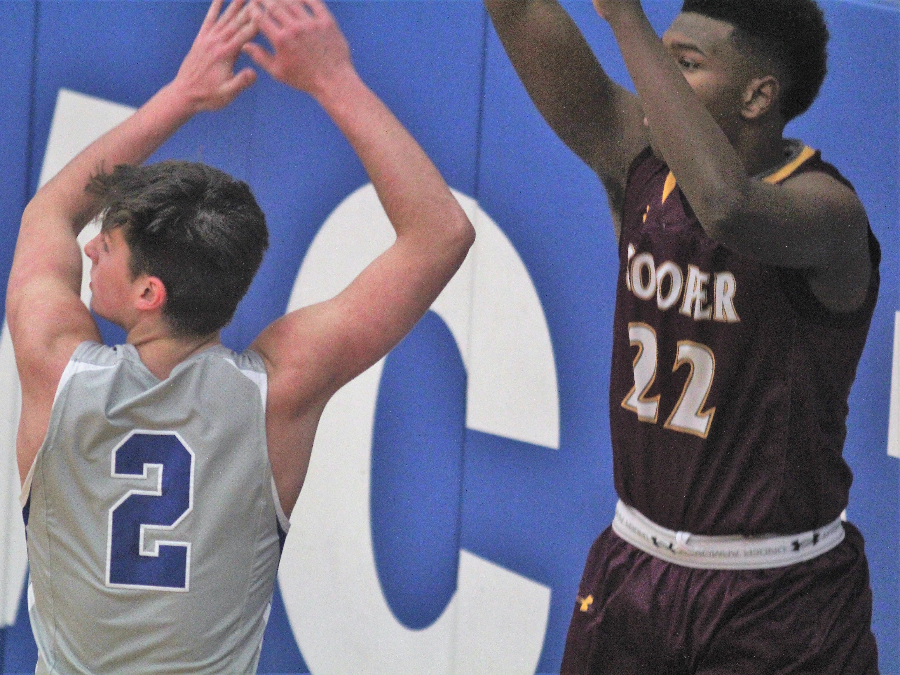 Cooper senior Michael Spencer inbounds over CovCath junior Grant Disken as Covington Catholic defeats Cooper 53-47 in boys basketball Jan. 11, 2019 at CovCath.