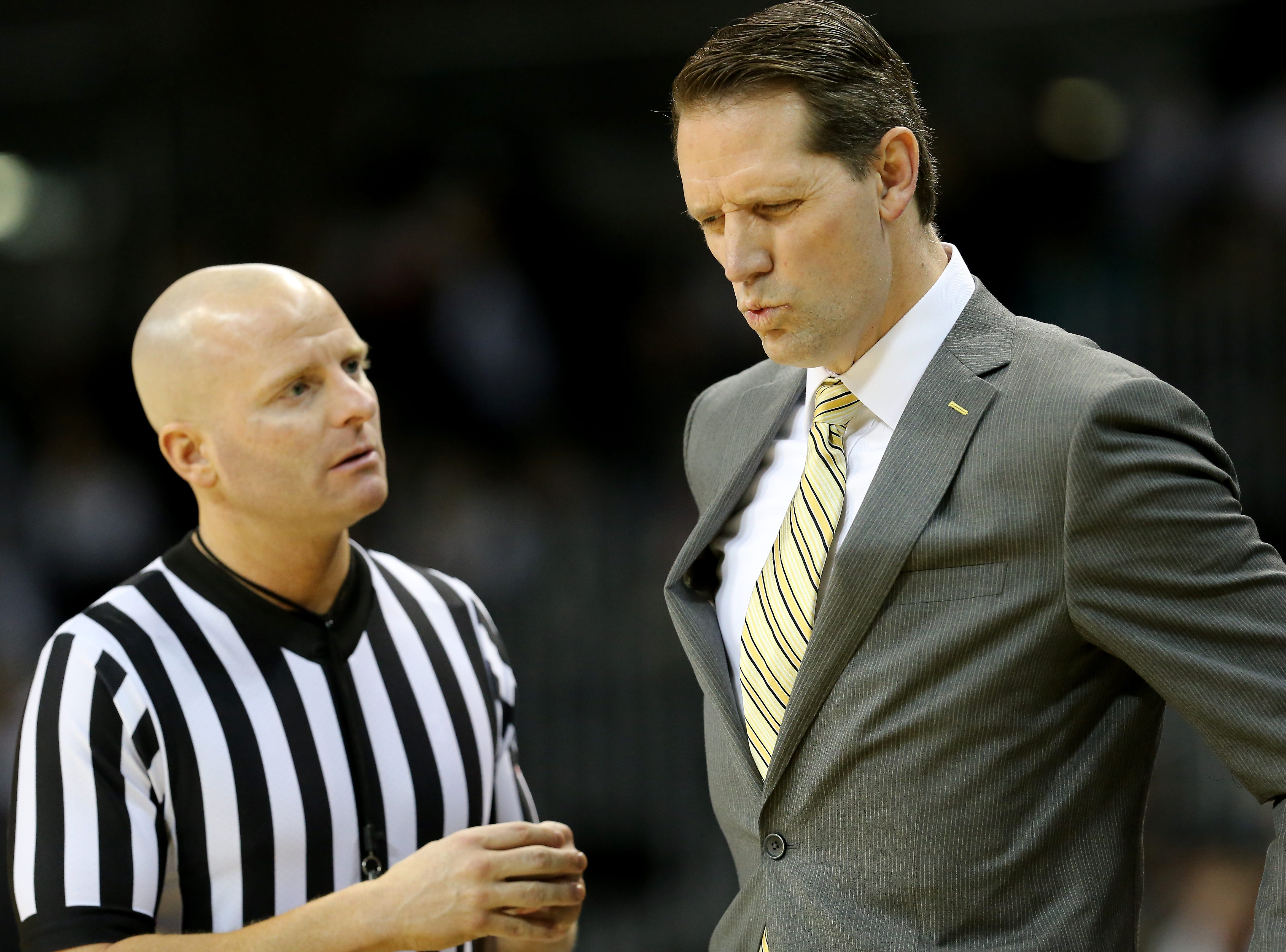 Northern Kentucky Norse head coach John Brannen reacts after receiving an explanation from an official in the second half of an NCAA basketball game against the Wright State Raiders, Friday, Jan. 11, 2019, at BB&T Arena in Highland Heights, Ky.