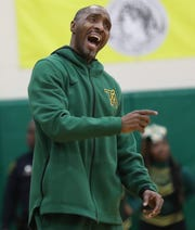 Taft head coach Demarco Bradley reacts during the Senators' basketball game against Aiken.