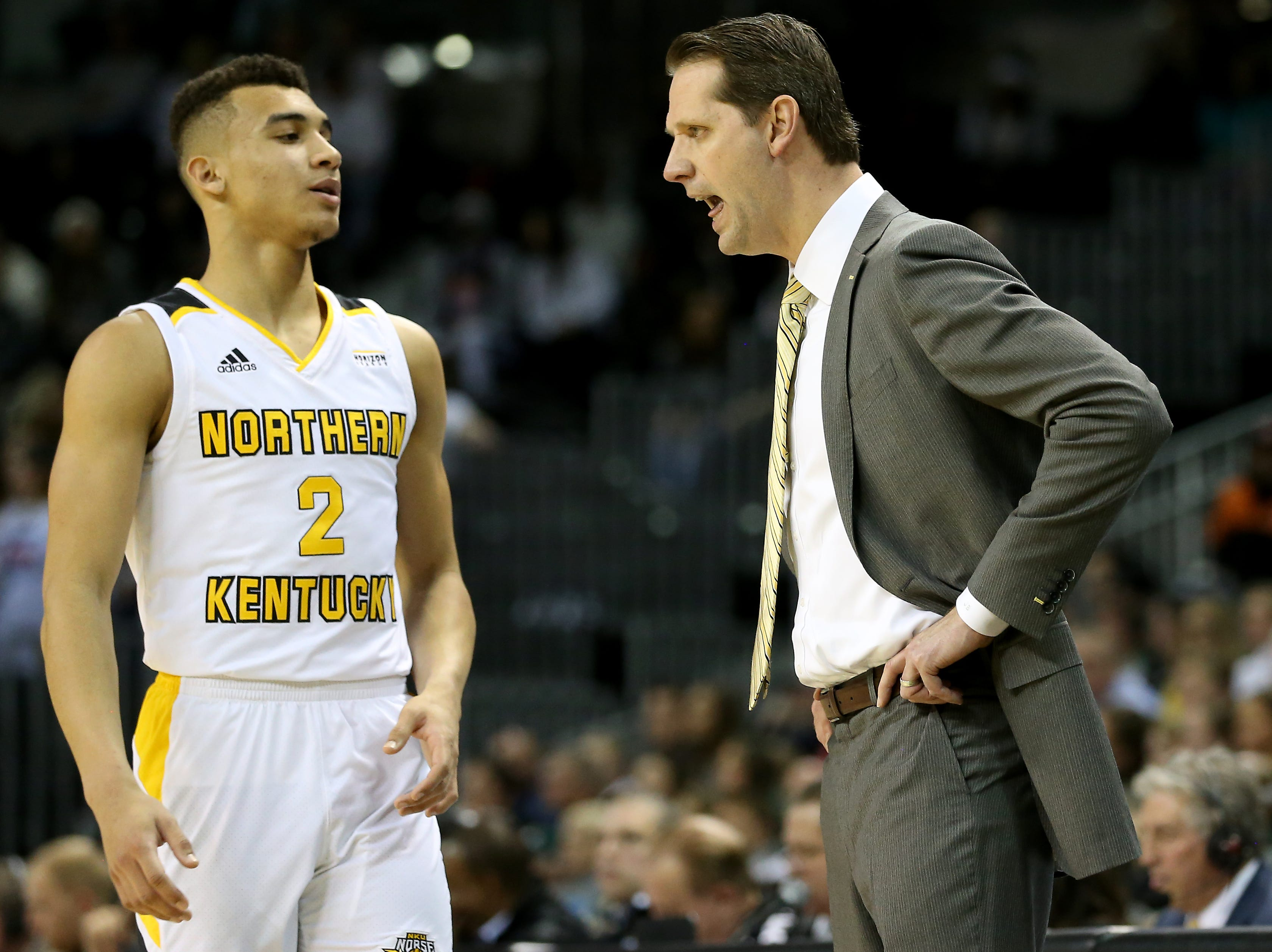 Northern Kentucky Norse head coach John Brannen gets in the ear of Northern Kentucky Norse guard Paul Djoko (2) in the second half of an NCAA basketball game against the Wright State Raiders, Friday, Jan. 11, 2019, at BB&T Arena in Highland Heights, Ky.