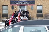 People pay their respects to Colerain Police Officer Dale Woods during the procession from Spring Grove Cemetery to Colerain High School.