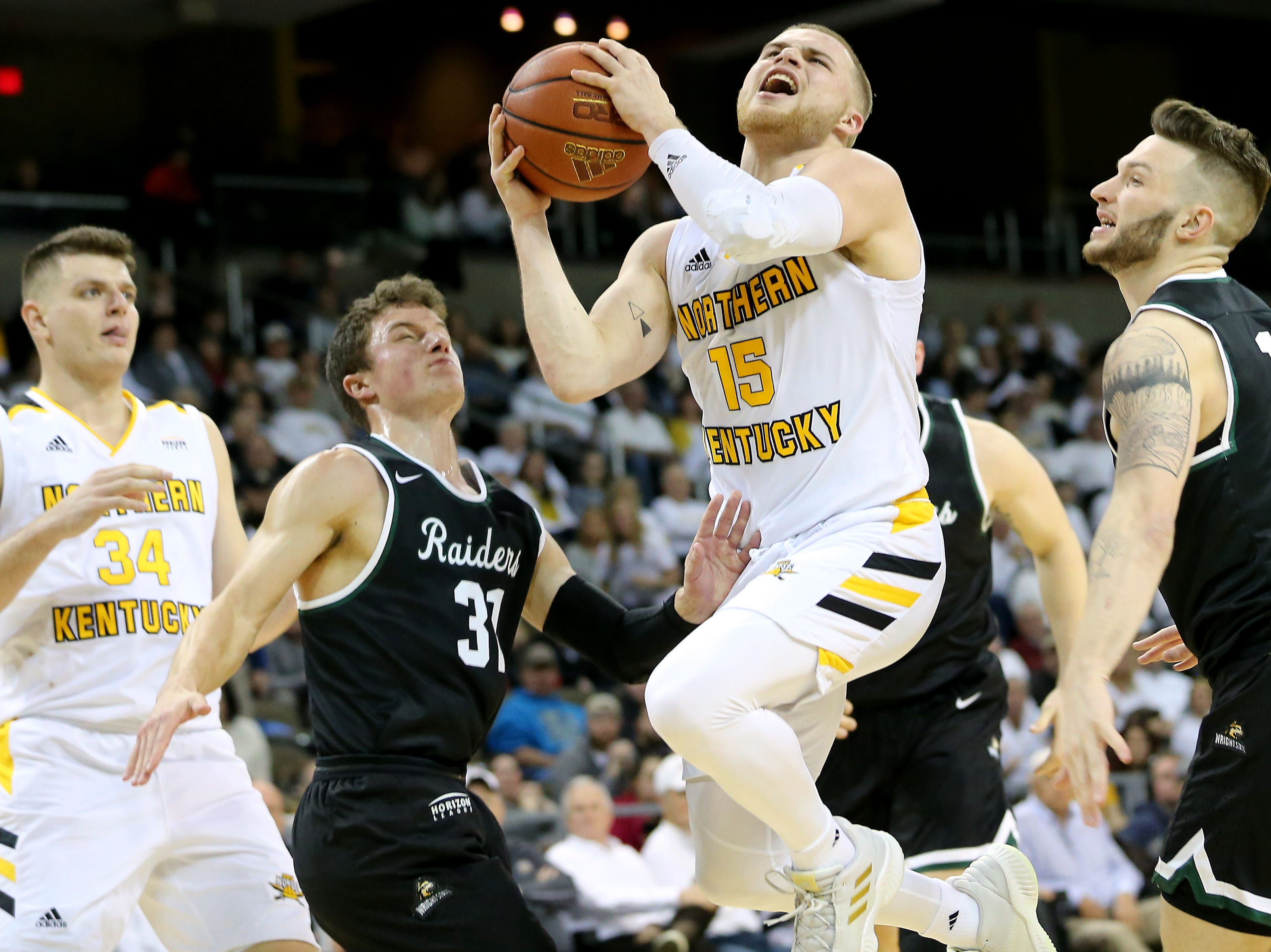 Northern Kentucky Norse guard Tyler Sharpe (15) drives to the basket in the second half of an NCAA basketball game against the Wright State Raiders, Friday, Jan. 11, 2019, at BB&T Arena in Highland Heights, Ky.